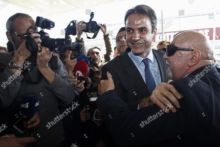 Supporters of New Democracy Party Welcomes Newly Elected President Kyriakos Mitsotakis (2-r) During His Entrance at the Headquarters of the Party in Athens Greece 11 January 2016 Kyriakos Mitsotakis Was Elected President of Main Opposition New Democracy (nd) in Runoff Elections On Sunday Defeating Vangelis Meimarakis Who Had Served As Interim Party Leader Over the Summer After Antonis Samaras Stepped Down