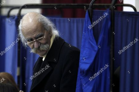 New Democracy Party Supporter Stands Next to Voting Booths During the Leadership Elections in Athens Greece 10 January 2016 New Democracy Supporters Were Voting in the Final Round of the Partys Leadership Election On Sunday Vangelis Meimarakis Faces Off Against Kyriakos Mitsotakis For New Democracys Presidency