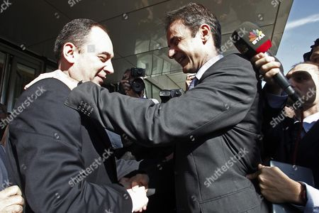 Outgoing President of New Democracy Party Yiannis Plakiotakis (l) Welcomes Newly Elected President Kyriakos Mitsotakis (r) During Their Meeting at the Headquarters of the Party in Athens Greece 11 January 2016 Kyriakos Mitsotakis Was Elected President of Main Opposition New Democracy (nd) in Runoff Elections On 10 January Defeating Vangelis Meimarakis Who Had Served As Interim Party Leader Over the Summer After Antonis Samaras Stepped Down
