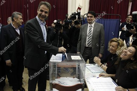 Candidate For the Presidency of New Democracy Party Kyriakos Mitsotakis (2l) Casts His Vote During the Leadership Elections in Athens Greece 10 January 2016 New Democracy Supporters Were Voting in the Final Round of the Partys Leadership Election On Sunday Vangelis Meimarakis Faces Off Against Kyriakos Mitsotakis For New Democracys Presidency