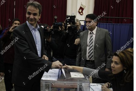 Candidate For the Presidency of New Democracy Party Kyriakos Mitsotakis (l) Casts His Vote During the Leadership Elections in Athens Greece 10 January 2016 New Democracy Supporters Were Voting in the Final Round of the Partys Leadership Election On Sunday Vangelis Meimarakis Faces Off Against Kyriakos Mitsotakis For New Democracys Presidency