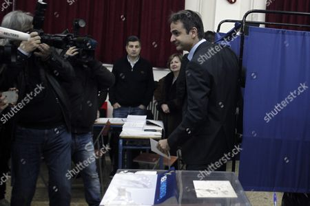 Candidate For the Presidency of New Democracy Party Kyriakos Mitsotakis (r) Leaves a Voting Booth During the Leadership Elections in Athens Greece 10 January 2016 New Democracy Supporters Were Voting in the Final Round of the Partys Leadership Election On Sunday Vangelis Meimarakis Faces Off Against Kyriakos Mitsotakis For New Democracys Presidency