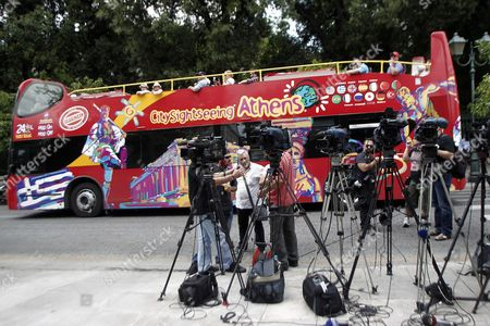 Tv Crews Are Seen Outside the Presidential Residence During a Meeting Between President Prokopis Pavlopoulos and Opposition New Democracy Leader Antonis Samaras in Athens Greece 28 June 2015 Uncertainty Reigned in Greece 28 June After Its Parliament Approved Prime Minister Alexis Tsipras' Bailout Referendum Leaving the Country Sharply Divided On the Issue of the Cost of Remaining in the Euro Common Currency Bloc the Pro-european Opposition Parties New Democracy Pasok and to Potami Accused the Government of Putting the Country On the Brink of an Exit From the Eurozone a Suggestion Played Down by the Ruling Leftist Syriza Tsipras Told Parliament Ahead of the Vote That the Referendum He Proposed On 26 June Was not a Tactic to Break Away From Europe While Former Prime Minister and Leader of New Democracy Antonis Samaras Said 'Greece Will not Commit Suicide with You '