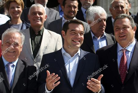 Greek Prime Minister Alexis Tsipras (c) Yannis Dragasakis (l) Vice President of the Government Panos Kammenos (r) Defense Minister and Other Ministers of His New Government Pose For a Family Photo in Front of the Greek Parliament Building in Athens On 25 September 2015