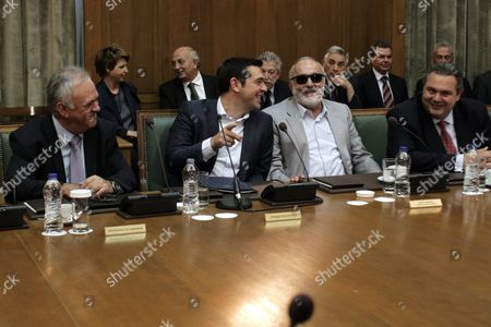 Greek Prime Minister Alexis Tsipras (2l) Talks with Vice President of the Government Yannis Dragasakis (l) Minister of Defence Panos Kammenos (r) and Minister of Interior Panayiotis Kouroumblis (2r) During a Cabinet Meeting of His New Government in the Greek Parliament Building in Athens Greece 25 September 2015