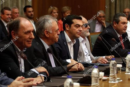 Greek Prime Minister Alexis Tsipras (3-l) Talks with Vice President of the Government Yannis Dragasakis (2-l) Minister of Defence Panos Kammenos (r) Minister of Interior Panayiotis Kouroumblis (2-r) and Minister of Economy Infastructure Shipping and Tourism George Stathakis (l) During a Cabinet Meeting of His New Government in the Greek Parliament Building in Athens Greece 25 September 2015