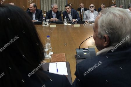 Greek Prime Minister Alexis Tsipras (2r) Talks with Vice President of the Government Yannis Dragasakis (2l) and Minister of Interior Panayiotis Kouroumblis (r) During a Cabinet Meeting of His New Government in the Greek Parliament Building in Athens Greece 25 September 2015