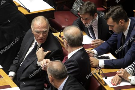 Newly Elected Leader of the Union of Centrists Vassilis Leventis (l) Talks with Mps From His Party During a Swearing-in Ceremony in the Greek Parliament in Athens Greece 03 October 2015 On 04 October the Deputies Will Elect the President and Vice-presidents of Parliament While in the Next Three Days the New Government Will Make Policy Announcements This Procedure Will Be Concluded On 07 October When Deputies Will Be Asked to Give a Vote of Confidence