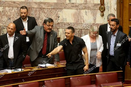 Lawmakers of Far-right Golden Dawn Party Christos Pappas (c-l) and Ilias Kasidiaris (c-r) Gesture During a Parliamentary Debate On the Draft Bill For Tax and Pensions Reforms in Athens Greece 08 May 2016 the Parliamentary Debate On the Draft Bill For Tax and Pensions Reforms Was Interrupted For Approximately One Hour On Sunday Evening Resuming After the Presidency Announced Its Decision to Expel Golden Dawn Mp Yannis Lagos From the Chamber During Sunday's Debate For Making Offensive Remarks About Environment and Energy Minister Panos Skourletis