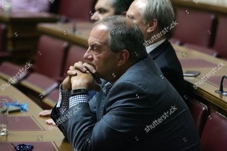 Former Prime Minister of Greece Costas Karamanlis (c) Listens to the Speech of the New Democracy Opposition Party Leader Antonis Samaras (not Pictured) Athens Greece 29 June 2015 Regarding Prime Minister's Alexis Tsipras (not Pictured) Referendum On Bailout Terms to Be Held On the 05 July 2015 Athens Greece 29 June 2015