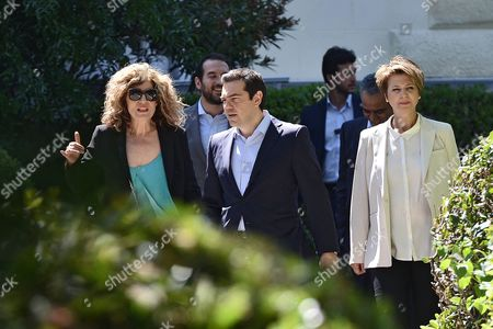 Greek Prime Minister Alexis Tsipras (c) Exits the Presidential Hall with New Spokewoman of the Government Olga Gerovasili (r) and the New Deputy Foreign Minister Sia Anagnostopoulou (l) After the Swearing-in Ceremony of the New Ministers at the Presidential Mansion in Athens Greece 18 July 2015 Prime Minister Alexis Tsipras Proceeded to a Cabinet Reshuffle Replacing Ministers That Have Either Resigned Or Had to Leave the Government