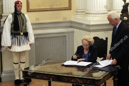 Greece's Caretaker Prime Minister Vassiliki Thanou Signs the Protocol of the Swearing-in Ceremony of the New Government's Caretaker Ministers in the Presidential Palace On 28 August 2015 Elections Will Be Held On 20 September 2015