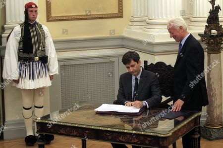 Greece's Caretaker Finance Minister George Chouliarakis Signs the Protocol of His Swearing-in in the Presidential Palace On 28 August 2015 Elections Will Be Held On 20 September 2015
