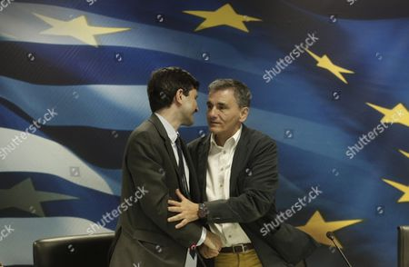 Caretaker Finance Minister George Chouliarakis (l) Embraces Outgoing Minister Euclid Tsakalos (r) During a Handover Ceremony at the Ministry in Athens Greece 28 August 2015 Elections Will Be Held On 20 September 2015