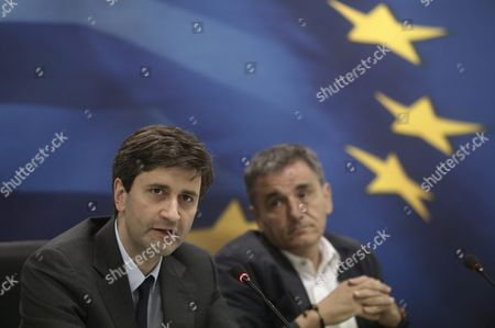 Caretaker Finance Minister George Chouliarakis (l) Addresses Reporters Next to Outgoing Minister Euclid Tsakalos During a Handover Ceremony at the Ministry in Athens Greece 28 August 2015 Elections Will Be Held On 20 September 2015