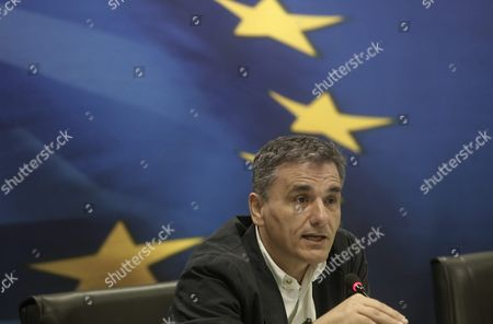 Outgoing Finance Minister Minister Euclid Tsakalotos Addresses Reporters During a Handover Ceremony Following the Swearing-in of Caretaker Finance Minister George Chouliarakis (not Pictured) at the Ministry in Athens Greece On 28 August 2015 Elections Will Be Held On 20 September 2015