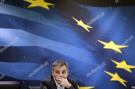 Outgoing Finance Minister Euclid Tsakalotos Attends a Handover Ceremony Following the Swearing-in of Caretaker Finance Minister George Chouliarakis (not Pictured) at the Ministry in Athens Greece On 28 August 2015 Elections Will Be Held On 20 September 2015