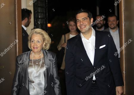 Stock Image of Greek Syriza Party Leader and Newly Sworn-in Prime Minister Alexis Tsipras (r) Enters the Prime Minister's Office Accompanied by Former Caretaker Prime Minister Vassiliki Thanou (l) During a Handover Ceremony in Athens Greece 21 September 2015 Alexis Tsipras is Set to Return to Power in Greece with Another Emphatic Election Victory Vindicating His Decision to Seek a New Mandate After Yielding to the Demands of European Leaders For More Austerity in the Crisis-hit Country