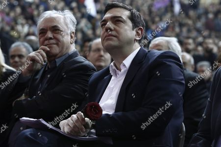 Greek Prime Minister Alexis Tsipras (r) Holds a Rose As He Sits Next to Deputy Prime Minister Yannis Dragasakis (l) During an Open Event On the Occasion of the First Year Anniversary of His Syriza Government in Athens Greece 24 January 2016 the Evaluation of Greece's Economic Program Must Be Completed As Soon As Possible Because It May Be Greece's Last Chance Prime Minister Alexis Tsipras Had Said in an Interview On the Sidelines of the Recent World Economic Forum Wef in Davos Switzerland On 22 January