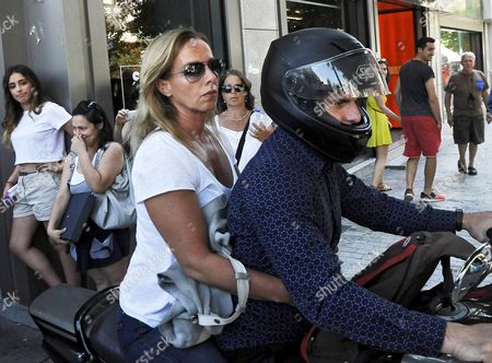 Greece's Former Finance Minister Yanis Varoufakis Drives His Motorcyle with His Wife Danae Stratou After Exiting the Finance Ministry in Athens Greece 05 July 2015 Greece's Finance Minister Yanis Varoufakis Said On 06 July He is Resigning Making the Announcement in a Tweet and On His Personal Webpage the Announcement Came Hours After the Ballot Count of the Referendum On Greece's Bailout Package Was Completed