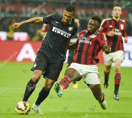 Inter Milan's Colombian Midfielder Fredy Guarin (l) Vies For the Ball with Ac Milan Ghanaian Midfielder Sulley Ali Muntari During the Italian Serie a Soccer Match Between Ac Milan and Fc Inter at Giuseppe Meazza Stadium in Milan Italy 23 November 2014