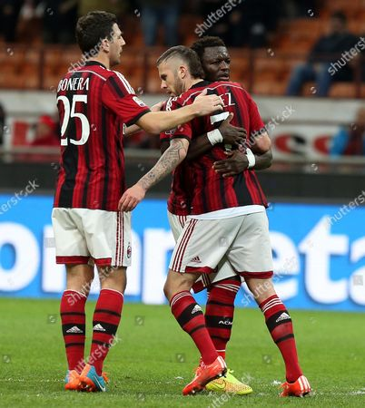 Ac Milan Forward Jeremy Menez (c) Celebrates with His Teammates Daniele Bonera (l) and Sulley Muntari After Scoring During the Italian Serie a Soccer Match Between Ac Milan and Hellas Verona at Giuseppe Meazza Stadium in Milan Italy 07 March 2015