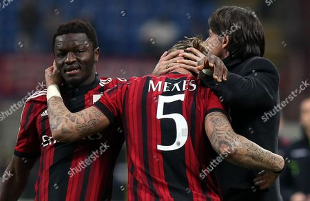 Ac Milan's Philippe Mexes (c) Celebrates with His Teammate Sulley Muntari (l) and His Coach Filippo Inzaghi After Scoring the 2-1 Goal During the Italian Serie a Soccer Match Between Ac Milan and Hellas Verona at Giuseppe Meazza Stadium in Milan Italy 07 March 2015