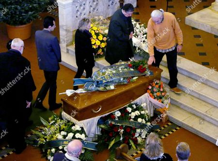 Stock Photo of People Pay Their Respects at the Coffin of Swedish Actress Anita Ekberg During the Funeral Service at the Evangelic Luteran Church of Rome Italy 14 January 2015 Ekberg Has Died Aged 83 On 11 January in a Hospital Just Outside Rome where She Had Been Living Wheelchair-bound For the Past Several Years