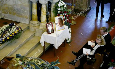 Pictures of Swedish Actress Anita Ekberg Are On Display Next to Her Coffin During the Funeral Service at the Evangelic Luteran Church of Rome Wednesday 14 January 2015 Ekberg Has Died Aged 83 On 11 January in a Hospital Just Outside Rome where She Had Been Living Wheelchair-bound For the Past Several Years