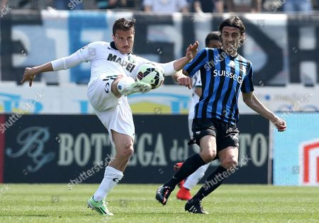 Giuseppe Biava (r) of Atalanta Vies For the Ball with Matteo Brighi of Sassuolo During Italian Serie a Soccer Match Between Atalanta and Sassuolo in Bergamo Italy 12 April 2015