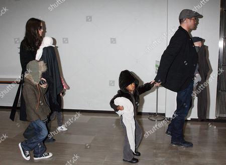 Editorial image of Brad Pitt and Angelina Jolie with family arriving at Narita International airport, Chiba, Japan - 27 Jan 2009