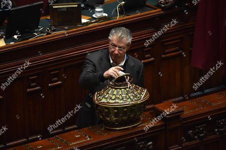 Northern League Party Lawmaker Umberto Bossi Casts His Ballot During the First Round of Voting to Choose a New President at the Deputies' Chamber in Rome Italy 29 January 2015 More Than 1 000 National and Regional Lawmakers From Both Houses of Parliament and Regional Representatives Are Set to Start Casting Their Ballots in the First Rounding of Voting to Elect a New President of Italy at 3pm Local Time Sergio Mattarella a Constitutional Court Judge Who Previously Served As a Christian Democrat Minister is the Lead Candidate However Conservatives Led by Former Premier Silvio Berlusconi Oppose His Candidature Rendering the Election Outcome Uncertain