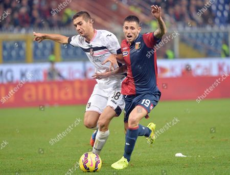 Genoa's Leandro Greco (r) and Palermo's Ivaylo Chocev (l) in Action During the Italian Serie a Match Between Genoa Cfc Vs Us Palermo at the Luigi Ferraris Stadium in Genoa Italy 24 November 2014