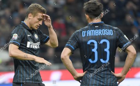 Inter Milan's Nemanja Vidic (l) Reacts Next to Teammate Danilo D'ambrosio During the Serie a Soccer Match Between Inter Milan and Ac Milan at the Giuseppe Meazza Stadium in Milan Italy 19 April 2015