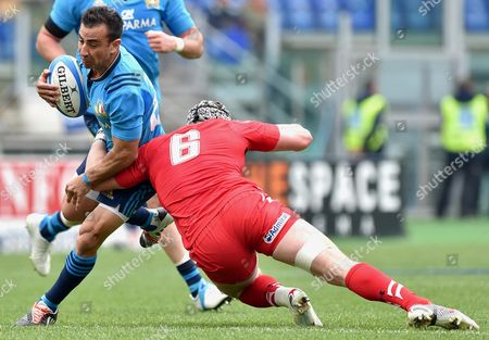 Italy's Luciano Orquera (l) in Action Against Wales' Dan Lydiate During the Six Nations Rugby Match Between Italy and Wales at Olimpico Stadium in Rome Italy 21 March 2015