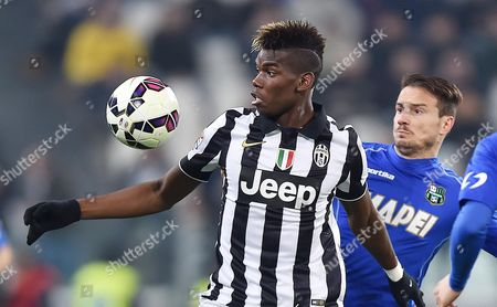 Juventus' Paul Pogba (l) and Sassuolo's Matteo Brighi in Action During the Italian Serie a Soccer Match Between Juventus Fc and Us Sassuolo Calcio at the Juventus Stadium in Turin Italy 09 March 2015