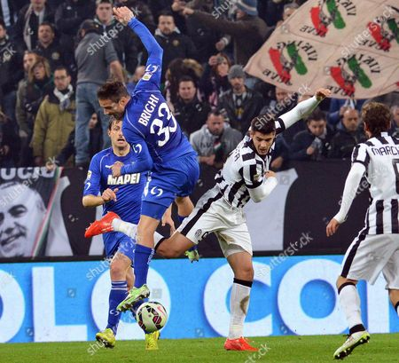 Juventus' Alvaro Morata (r) and Sassuolo's Matteo Brighi in Action During the Italian Serie a Soccer Match Between Juventus Fc and Us Sassuolo Calcio at the Juventus Stadium in Turin Italy 09 March 2015
