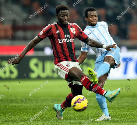 Milan's Sulley Muntari (l) and Lazio's Nigerian Ogenyi Onazi (r) Vie For the Ball During Their Italy Cup Quarterfinal Soccer Match Ac Milan Vs Lazio Rome at the Giuseppe Meazza Stadium in Milan Italy 27 January 2015