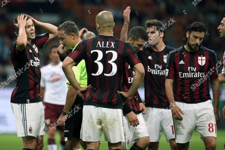 Milan's Players React After Milan's Cristian Zaccardo (r) Was Sent Off the Pitch with a Red Card During the Italian Serie a Soccer Match Between Ac Milan and Fc Torino at Giuseppe Meazza Stadium in Milan Italy 24 May 2015