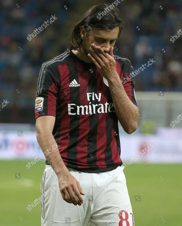 Milan's Cristian Zaccardo Leaves the Pitch After He Was Given a Red Card During the Italian Serie a Soccer Match Between Ac Milan and Fc Torino at Giuseppe Meazza Stadium in Milan Italy 24 May 2015