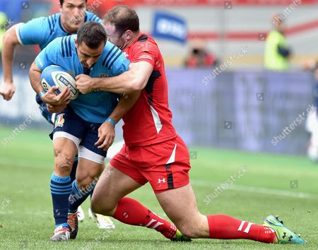 Italy's Luciano Orquera (l) in Action Against Wales' Jamie Roberts During the Six Nations Rugby Match Between Italy and Wales at Olimpico Stadium in Rome Italy 21 March 2015