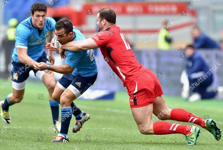 Stock Image of Italy's Luciano Orquera (l) in Action Against Wales' Jamie Roberts During the Six Nations Rugby Match Between Italy and Wales at Olimpico Stadium in Rome Italy 21 March 2015