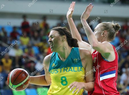 Elizabeth Cambage (l) of Australia Competes For the Ball with Jelena Milovanovic (r) of Serbia During Women's Quarterfinal Basketball Game of the Rio 2016 Olympic Games at the Carioca Arena 1 in the Olympic Park in Rio De Janeiro Brazil 16 August 2016 Brazil Rio De Janeiro