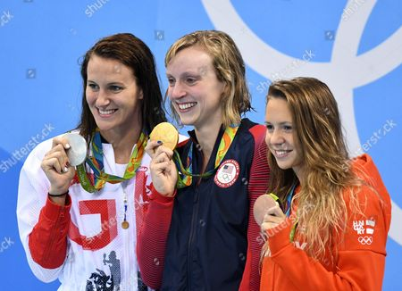 Silver Medalist Jazz Carlin of Great Britain (l-r) Gold Medalist Katie Ledecky of Usa and Bronze Medalist Boglarka Kapas of Hunfgary React on the Podium During the Medal Ceremony For the Women's 800m Freestyle Final Race of the Rio 2016 Olympic Games Swimming Events at Olympic Aquatics Stadium at the Olympic Park in Rio De Janeiro Brazil 12 August 2016 Brazil Rio De Janeiro