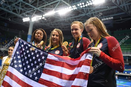 Gold Medalists Simone Manuel (l-r) Kathleen Baker Dana Vollmer and Lilly King of Usa Pose For the Media During the Lap of Honour After the Medal Ceremony For the Women's 4x100m Medley Relay Final Race of the Rio 2016 Olympic Games Swimming Events at Olympic Aquatics Stadium at the Olympic Park in Rio Brazil Rio De Janeiro