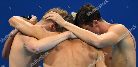 Townley Haas (l-r) Michael Phelps Ryan Lochte (hidden) and Conor Dwyer React After Winning the Men's 4x200m Freestyle Relay Race of the Rio 2016 Olympic Games Swimming Events at Olympic Aquatics Stadium at the Olympic Park in Rio De Janeiro Brazil 09 August 2016 Brazil Rio De Janeiro