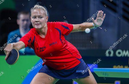 Georgina Pota of Hungary in Action Against How Kem Doo of Hong Kong During a Second Round Rio 2016 Olympic Games Women's Table Tennis Match at Riocentro in Rio De Janeiro Brazil 07 August 2016 Brazil Rio De Janeiro