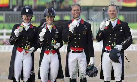 Silver Medalists Fiona Bigwood Charlotte Dujardin Carl Hester and Spencer Wilton of Great Britain React During the Medal Ceremony For the Dressage Team Grand Prix Special at the Olympic Equestrian Center in Deodoro Rio De Janeiro Brazil 12 August 2016 Brazil Rio De Janeiro