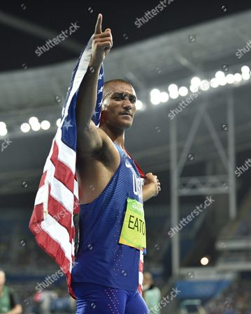 Ashton Eaton of the Usa Celebrates After Running the Men's Decathlon 1500m Race to Win the Gold Medal with Ther Over-all Points in the Decathlon of the Rio 2016 Olympic Games Athletics Track and Field Events at the Olympic Stadium in Rio De Janeiro Brazil 18 August 2016 Brazil Rio De Janeiro