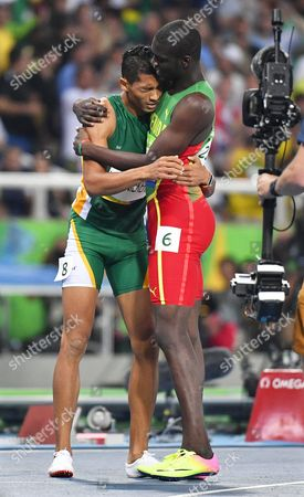 Wayde Van Niekerk (l) of South Africa is Embraced by Second Placed Kirani James (r) of Grenada After Winning the Men's 400m Final of the Rio 2016 Olympic Games Athletics Track and Field Events at the Olympic Stadium in Rio De Janeiro Brazil 14 August 2016 Van Niekerk Set a New World Record Time of 43 03 Seconds Brazil Rio De Janeiro